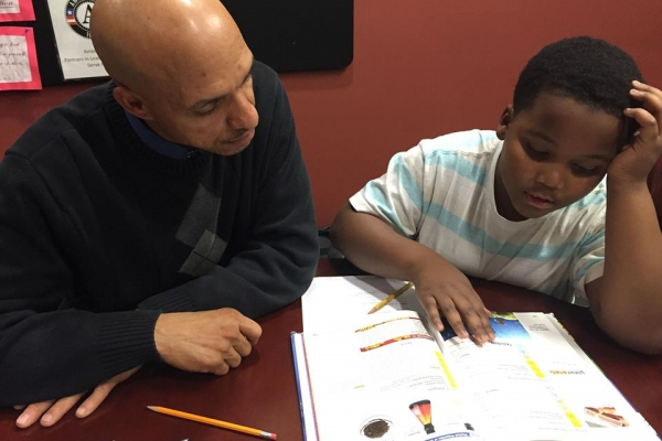 Volunteer Tutoring a Youth
